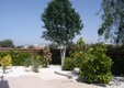 Villa Timily. Wheelchair accessible villa rental. Garden to right, hills